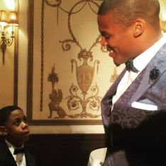 Cam Newton with Child at BBBS Dinner